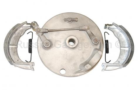Front brake drum cover with brake shoes and spring...